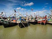 07 NOVEMBER 2014 - SITTWE, RAKHINE, MYANMAR: Fishing boats in the port of a Rohingya IDP camp near Sittwe. The government of Myanmar has forced more than 140,000 Rohingya Muslims who used to live in Sittwe, Myanmar, into squalid Internal Displaced Person (IDP) camps. The forced relocation took place in 2012 after sectarian violence devastated Rohingya communities in Sittwe and left hundreds dead. None of the camps have electricity and some have been denied access to regular rations for nine months. Conditions for the Rohingya in the camps have fueled an exodus of Rohingya refugees to Malaysia and Thailand. Tens of thousands have put to sea in rickety boats hoping to land in Malaysia but sometimes landing in Thailand. The exodus has fueled the boat building boom on the waterfront near the camps. Authorities expect the pace of refugees fleeing Myanmar to accelerate during the cool season, December through February, when there are fewer storms in the Andaman Sea and Bay of Bengal.   PHOTO BY JACK KURTZ