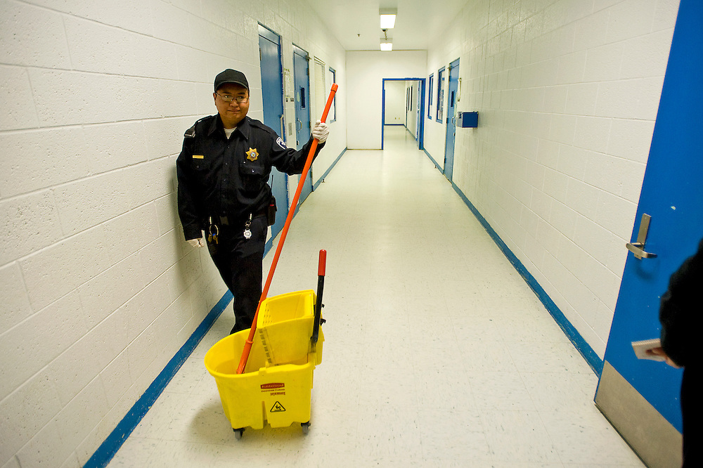101310       Brian Leddy.McKinley County Adult DEtention Center Correctional Officer Steve Tso pushes a mop bucket on Tuesday at the jail.