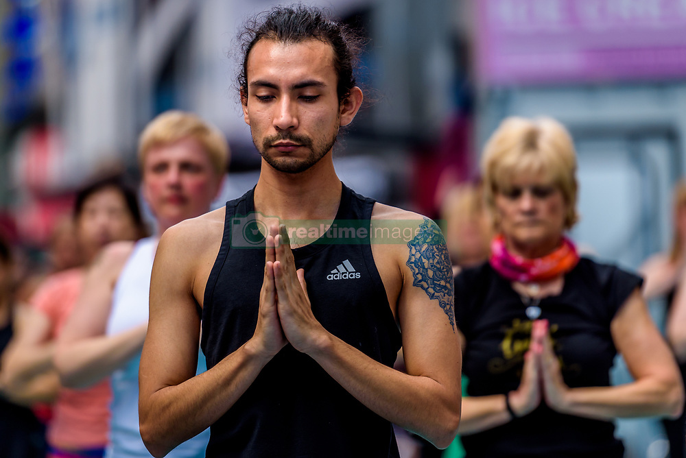 June 21, 2017 - New York, New York, United States - Solstice in Times Square: Mind Over Madness Yoga - Find your center at the Crossroads of the World. Each year, on June 21, 2017; the northern hemisphere's longest day of the year, thousands of yogis from around the world travel to Times Square to celebrate the Summer Solstice with free yoga classes taking place all day long in the heart of New York City. (Photo by Erik McGregor/Pacific Press) (Credit Image: © Erik Mcgregor/Pacific Press via ZUMA Wire)