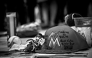A Miami Marlins hat lies down in front of the home plate gate of Marlins Park where fans leave offerings to honor the life of Jose Fernandez.