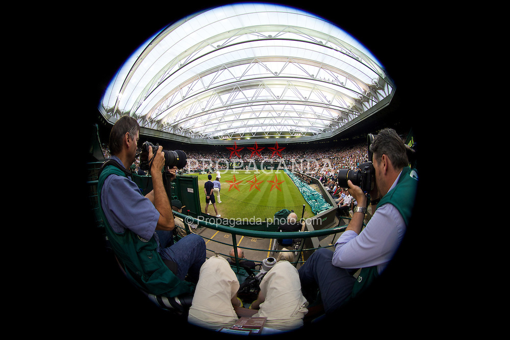 LONDON, ENGLAND - Monday, June 30, 2014: A view from photographer's platform B on centre court during the Gentlemen's Singles 4th Round match on day seven of the Wimbledon Lawn Tennis Championships at the All England Lawn Tennis and Croquet Club. (Pic by David Rawcliffe/Propaganda)