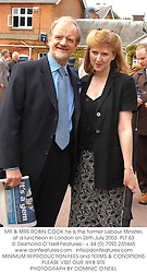 MR & MRS ROBIN COOK he is the former Labour Minister, at a luncheon in London on 26th July 2003.PLT 63