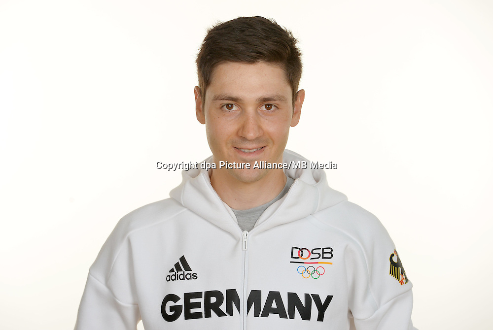 Emanuel Buchmann poses at a photocall during the preparations for the Olympic Games in Rio at the Emmich Cambrai Barracks in Hanover, Germany. July 27, 2016. Photo credit: Frank May/ picture alliance. | usage worldwide
