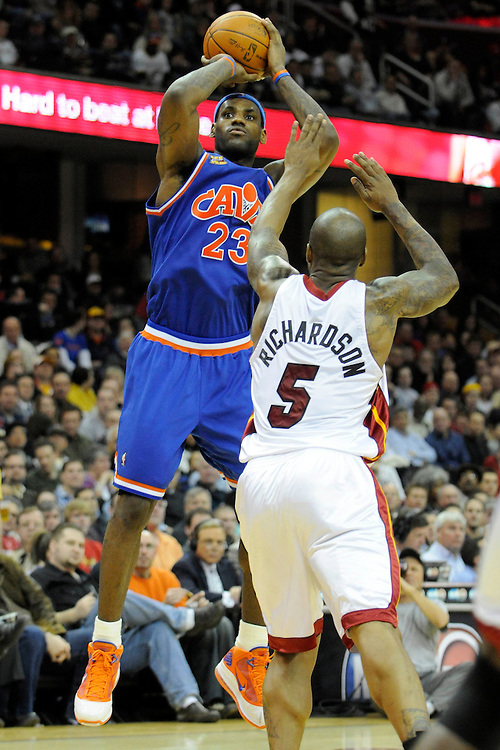 Feb 4, 2010; Cleveland, OH, USA; Cleveland Cavaliers forward LeBron James (23) shoots a jump shot over Miami Heat guard Quentin Richardson (5) during the third quarter at Quicken Loans Arena. The Cavaliers beat the Heat 102-86. Mandatory Credit: Jason Miller-US PRESSWIRE
