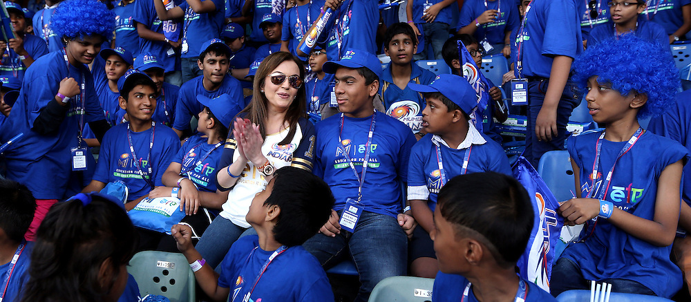Nita Ambani owner of Mumbai Indians with MUMBAI EDUCTION FOR ALL kids during match 23 of the Pepsi IPL 2015 (Indian Premier League) between The Mumbai Indians and The Sunrisers Hyferabad held at the Wankhede Stadium in Mumbai India on the 25th April 2015.<br /> <br /> Photo by:  Sandeep Shetty / SPORTZPICS / IPL