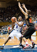 Duke Blue Devils guard Nolan Smith (2) drives inside guarded by Maryland Terrapins guard/forward Cliff Tucker (24). Duke beats Maryland 71-64 at Cameron Indoor Stadium