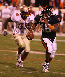 UVA QB Marques Hagans (18) escapes the rush of Florida State's Marcello Church (39) on October 15, 2005.  The Cavaliers upset #4 Florida State 26-21 at Scott Stadium in Charlottesville, VA.<br />