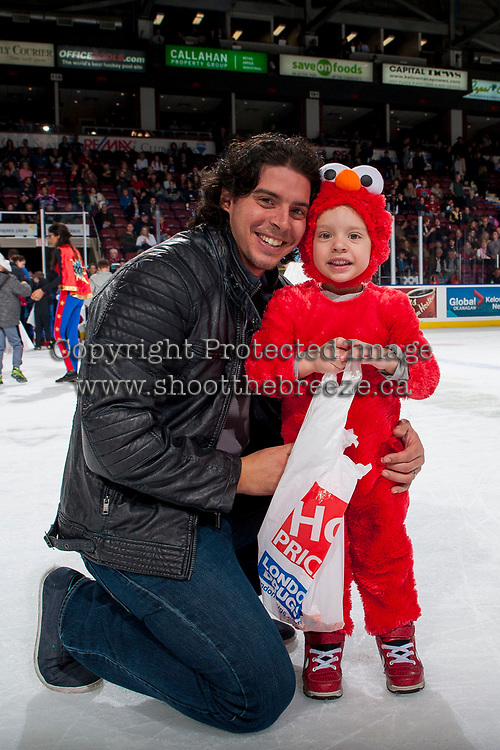 KELOWNA, CANADA - OCTOBER 28: Andrew and Austin Locurto pose on the ice after the London Drugs Hershey's candy scramble during intermission against the Prince George Cougars on October 28, 2017 at Prospera Place in Kelowna, British Columbia, Canada.  (Photo by Marissa Baecker/Shoot the Breeze)  *** Local Caption ***