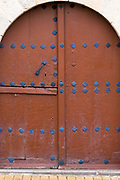 Arched doorway in traditional old style with iron metal studs at Ororbia (Olza) in Basque region of Northern Spain