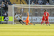 York City goalkeeper Scott Flinders saves from Notts County forward Izale McLeod during the Sky Bet League 2 match between Notts County and York City at Meadow Lane, Nottingham, England on 26 September 2015. Photo by Simon Davies.