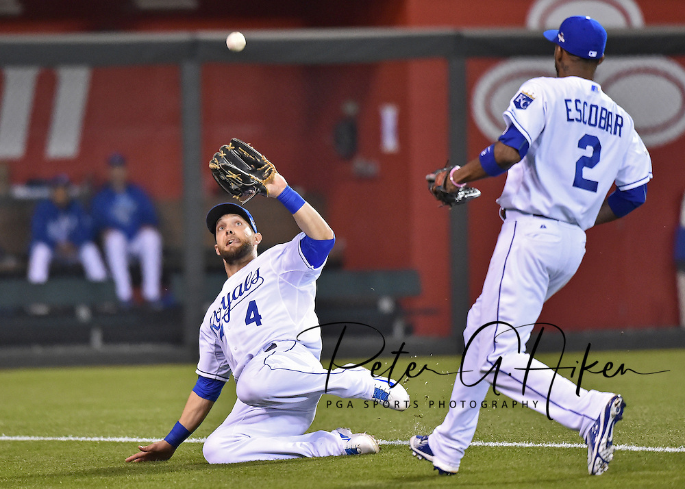Oct 9, 2015; Kansas City, MO, USA; Kansas City Royals left fielder Alex Gordon (4) makes a sliding catch against the Houston Astros in game five of the ALDS at Kauffman Stadium. Mandatory Credit: Peter G. Aiken-USA TODAY Sports