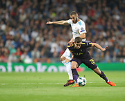 Karim Benzema against and Harry Winks  during the Champions League match between Real Madrid and Tottenham Hotspur at the Santiago Bernabeu Stadium, Madrid, Spain on 17 October 2017. Photo by Ahmad Morra.
