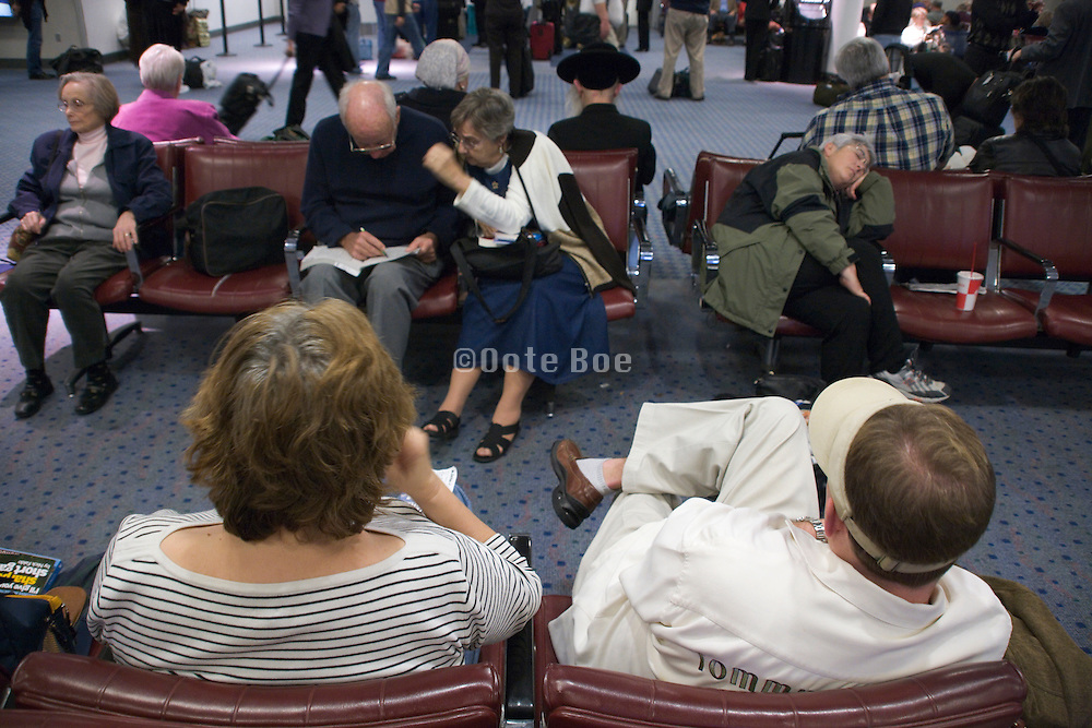 passengers waiting in an airport lounge