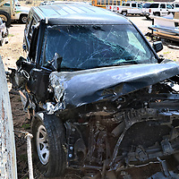 The Navajo Nation government vehicle that Office of the President and Vice President attorney Karis Begaye wrecked in a DWI accident with a semitruck April 22 near Flagstaff, Arizona, sits inside the fenced lot of tribal fleet management in Window Rock , Arizona, Thursday.
