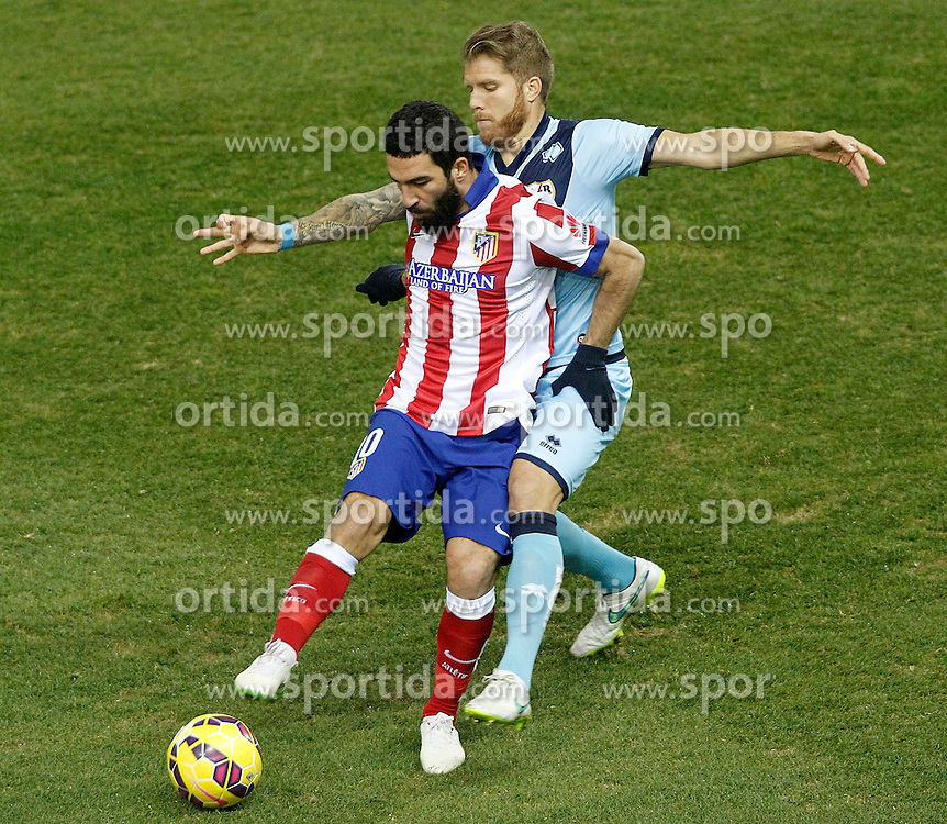 24.01.2015, Estadio Vicente Calderon, Madrid, ESP, Primera Division, Atletico Madrid vs Rayo Vallecano, 20. Runde, im Bild Atletico de Madrid's Arda Turan (l) and Rayo Vallecano's Jorge Garcia Morcillo // uring the Spanish Primera Division 20th round match between Club Atletico de Madrid and Rayo Vallecano at the Estadio Vicente Calderon in Madrid, Spain on 2015/01/24. EXPA Pictures &copy; 2015, PhotoCredit: EXPA/ Alterphotos/ Acero<br /> <br /> *****ATTENTION - OUT of ESP, SUI*****