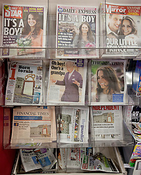 © Licensed to London News Pictures. 23/07/2013. London, UK. Newspapers showing Royal Baby associated headlines are seen in central London today (23/07/2013), the day after Catherine, Duchess of Cambridge, gave birth to a new heir to the throne. Photo credit: Matt Cetti-Roberts/LNP