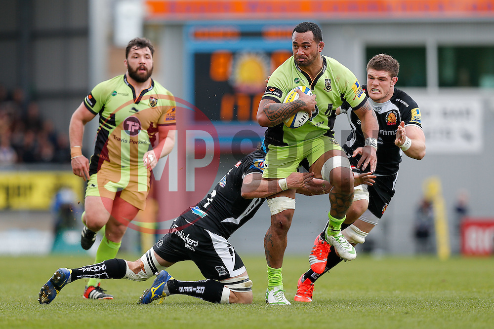 Northampton Lock Samu Manoa is tackled by Exeter Chiefs Flanker Ben White and Flanker Dave Ewers - Photo mandatory by-line: Rogan Thomson/JMP - 07966 386802 - 11/04/2015 - SPORT - RUGBY UNION - Exeter, England - Sandy Park Stadium - Exeter Chiefs v Northampton Saints - Aviva Premiership.