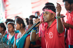 14 September 2018, Laxmipur, Nepal: Youth leader Karan Besara leads a moment of song an prayer, as more than 800 congregants, guests and dignitaries celebrate the 75th anniversary of the Nepal Evangelical Lutheran Church, an LWF member church.