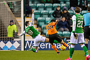Lawrence Shankland (#24) of Dundee United FC scores the opening goal during the William Hill Scottish Cup fourth round match between Hibernian FC and Dundee United FC at Easter Road Stadium, Edinburgh, Scotland on 28 January 2020.