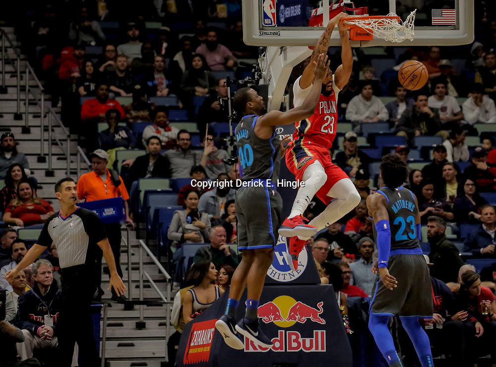Dec 5, 2018; New Orleans, LA, USA; New Orleans Pelicans forward Anthony Davis (23) dunks over Dallas Mavericks forward Harrison Barnes (40) and guard Wesley Matthews (23) during the first quarter at the Smoothie King Center. Mandatory Credit: Derick E. Hingle-USA TODAY Sports