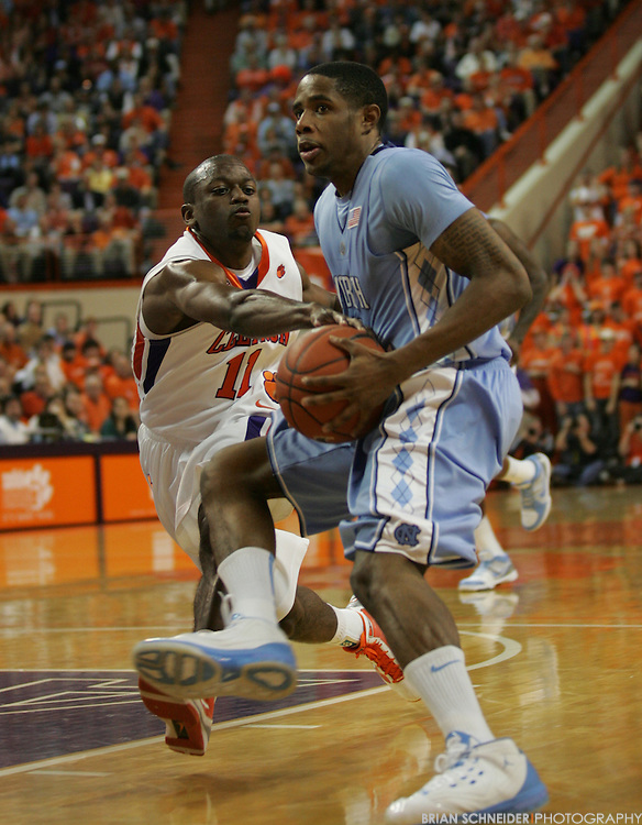 Jan 13, 2010; Clemson, SC, USA; North Carolina Tar Heels guard Larry Drew II (11) is defend by Clemson Tigers guard Andre Young (11) during the first half at Littlejohn Coliseum. Mandatory Credit: Brian Schneider-www.ebrianschneider.com