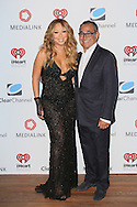 CAP D'ANTIBES, FRANCE - JUNE 17:  Mariah Carey AND Michael Kassan, MediaLink CEO and Chairman attend Clear Channel Media And Entertainment And MediaLink Dinner at Hotel du Cap-Eden-Roc on June 17, 2014 in Cap d'Antibes, France.  (Photo by Tony Barson/Getty Images for Clear Channel)