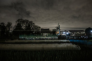 Evening clouds settle in over a rice field and a Buddhist temple on a warm autumn night.  Fuchu, Tokyo, Japan