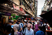 Hong Kong, China - Pedestrians walk past market stalls on Apliu Street in the Sham Shui Po district of Hong Kong on May 02, 2018. Hong Kong, a city of soaring skyscrapers and glittering luxury boutiques, has become perhaps the epitome of income inequality in the developed world. The struggle to help its citizens improve their lives may represent the greatest challenge to its unique economic model.