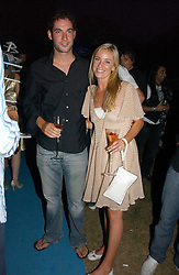 TAMZIN OUTHWAITE and her husband TOM ELLIS at a party to celebrate FilmFour becoming the UK's first major free film channel held at Debenham House, Addison Road, London on 20th July 2006.<br />