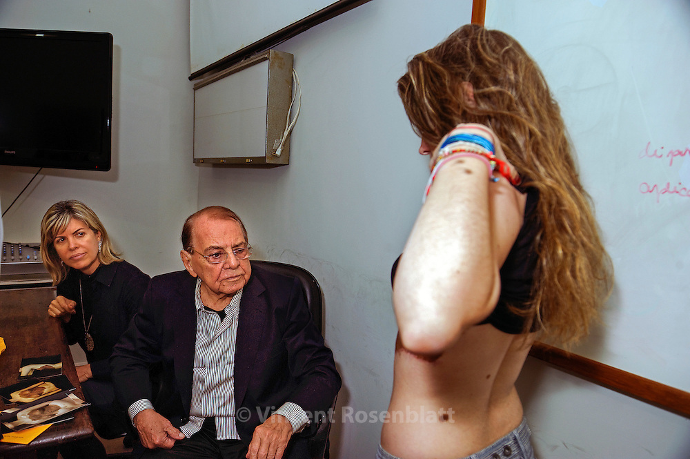 Pr. Ivo Pitanguy commands the Plastic Surgery Dpt. of the PUC university located at the Santa Casa de Misericordia, a charity hospital, since 1960. Half of the interns are Brazilians, the other are from all over the World. Low middle class and poor people can receive restorative & plastic surgery for only administrative coast. He still supervises the most difficult cases, presented each week by his students.