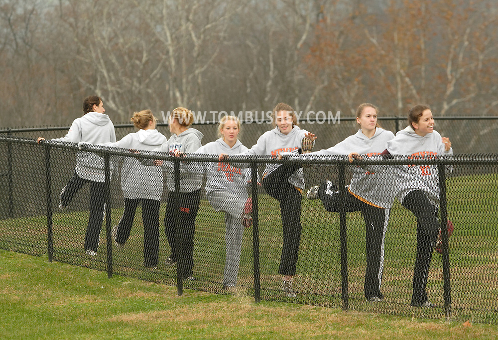 Warwick, N.Y. - A girls' cross country team warms up before the New York State Public High School Athletic Association championships at Sanfordville Elementary School on Nov. 11, 2006.<br />