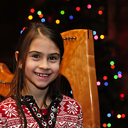 Young visitor enjoys Celtic Harps during Candle Light Stroll at Strawbery Banke, Portsmouth, NH Dec. 2010