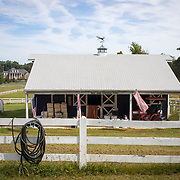Lauren Reed's property, Holly House Plantation Stable, is increasingly surrounded by mansions in North Potomac, Maryland. The United States, North Carolina and Confederate Battle flags all hang from the stable. Reed considers the mansions an eyesore and points out that Potomac's original beauty was because of the horses. Her last horse died in March this year and she doesn't plan to own any more on her 5 acre plot. Maryland's 6th District was redistricted in 2011, combining rural northern Maryland regions with more affluent communities like Potomac and Germantown. <br /> <br /> Tuesday, September 26, 2017. CREDIT: John Boal for The Wall Street Journal<br /> GERRYMANDER