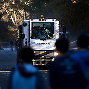 NYTRUN - NOV. 6, 2016 - NEW YORK - Street sweepers clear fallen leaves and litter from East Drive in Central Park on Sunday morning -- on the race route -- in anticipation of the start of the 2016 TCS New York City Marathon. NYTCREDIT:  Karsten Moran for The New York Times