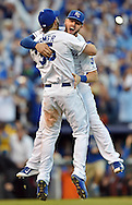 Kansas City Royals infielders Eric Hosmer (35) and Mike Moustakas (8) celebrate after defeating the Baltimore Orioles in game four of the 2014 ALCS playoff baseball game at Kauffman Stadium. The Royals swept the Orioles to advance to the World Series.