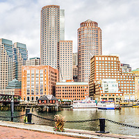 Boston Skyline harborwalk panorama picture with Rowes Wharf, downtown Boston skyscrapers and Nothern Avenue Bridge. Panoramic photo ratio is 1:3.