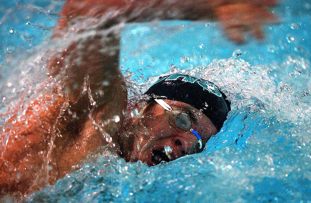 JEROME A. POLLOS/Press..Matt Heston, of Lake City, comes up for breath on his return lap of the 50-yard freestyle race Wednesday. Heston finished first with a time of 23.29 seconds.
