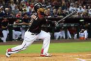 PHOENIX, AZ - MAY 28:  Jean Segura #2 of the Arizona Diamondbacks hits a sacrifice fly to right field driving in a run in the second inning against the San Diego Padres in the game at Chase Field on May 28, 2016 in Phoenix, Arizona.  (Photo by Jennifer Stewart/Getty Images)