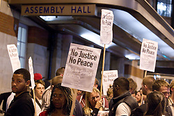 © Licensed to London News Pictures . 21/08/2012 . London , UK . Protesters march from Lambeth Town Hall to Brixton police station to demonstrate against deaths in police custody . Relatives of Sean Rigg , who died in police custody in August 2008 , lead the march . Video has emerged of a man being detained in Brixton on Sunday ( 19th August ) during which it is alleged police officers stamped on his head . Protesters delivered a formal complaint about the incident to the counter of Brixton Police Station , following the march . Photo credit : Joel Goodman/LNP