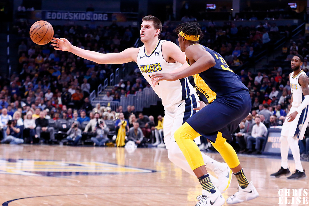 03 April 2018: Denver Nuggets center Nikola Jokic (15) passes the ball past Indiana Pacers center Myles Turner (33) during the Denver Nuggets 107-104 victory over the Indiana Pacers, at the Pepsi Center, Denver, Colorado, USA.