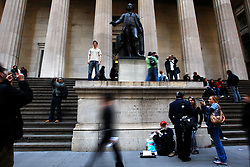Tourists and locals outside the Federal Hall in Wall Street in New York, New York, USA, 20 October 2008. As Wall Street descend into a financial turmoil not seen since the stock market crash of 1929 and financial businesses were pommeled into rampant sell-offs in stocks and face regulatory changes to their business practices, professionals and non-professionals working in the district's banks, stock-trading houses and insurance companies are showing stress and a gloom not unlike the times of the Great Depression.