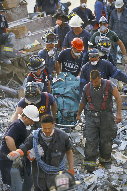 A body being removed from the rubble two days after the Twin Towers were brought down by a terrorist attack on the World Trade Center in New York City on September 11, 2001. Photo by Lisa Quinones