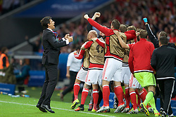 5LILLE, FRANCE - Friday, July 1, 2016: Wales manager Chris Coleman and the substitute players celebrate their sides first goal score by captain Ashley Williams during the UEFA Euro 2016 Championship Quarter-Final match  against Belgium at the Stade Pierre Mauroy. (Pic by Paul Greenwood/Propaganda)