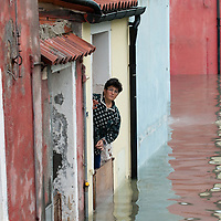 A woman worryingly looks outside her house in flooded Burano. More than 59% of Venice was under water on Thursday, as the historic lagoon town was hit by exceptionally high tides. The sea level rose above 140cm overnight and was expected to remain above critical levels for about 15 hours.
