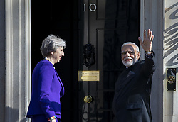 April 18, 2018 - London, UK - Indian Prime Minister Narendra Modi (R) waves as he meets Prime Minister Theresa May at 10 Downing Street. (Credit Image: © Rob Pinney/London News Pictures via ZUMA Wire)