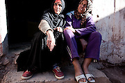 "Maria (left), 44 years old, and Kadija, age 28, are two sex workers who live in an old souk, Tamsult, that had just gone out of business in the '80s, at 1200 mt of altitude. This desolated place is known by all as the crossroads for sex. A group of sex workers occupy the walled and abandoned boutiques. Most of the whores, in the maroccan mountains, live around souks, the main places for any kind of business..January 2010, Tamsult, Anti-Atlas mountains, Morocco.....The misery of a square bare, dirt, dotted with broken glass and cans, brick structures close the doors of old shops, stray dogs and the ghosts of women who inhabit it. Are Taidit, are ""bitches"", are prostitutes and are the renters of an old souk abandoned at 1200 meters in the heart of the Anti-Atlas Mountains of Morocco. The time when the market was full of merchants and sellers gave place to the vendors of their own bodies...To protect the identities of the recorded subjects names are fictional."