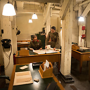 Room 62A, the Advanced Headquarters of the GHQ, Home Forces, at the Churchill War Rooms in London. The museum, one of five branches of the Imerial War Museums, preserves the World War II underground command bunker used by British Prime Minister Winston Churchill. Its cramped quarters were constructed from a converting a storage basement in the Treasury Building in Whitehall, London. Being underground, and under an unusually sturdy building, the Cabinet War Rooms were afforded some protection from the bombs falling above during the Blitz.