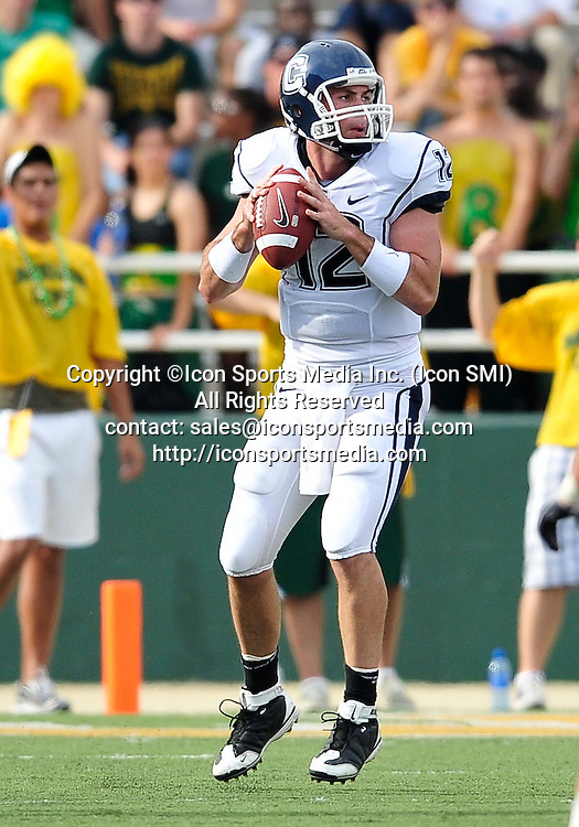 September 19th 2009:  <br /> Connecticut quarterback Cody Endres (12)<br /> in action during a NCAA Football game between the Baylor Bears and the University of Connecticut at Floyd Casey  Stadium in Waco, TX.  <br /> Baylor loses to UConn 30-22
