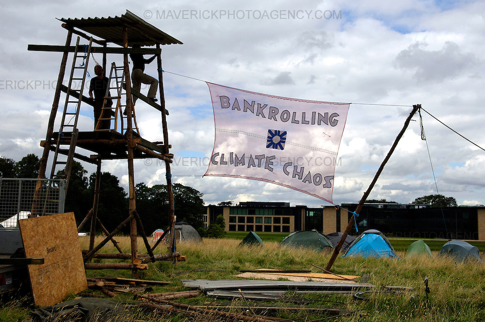 EDINBURGH, UK - 19th August 2010: Climate change protesters have set up camp close to the Royal Bank of Scotland headquarters in Edinburgh...The Camp for Climate Action is protesting about RBS's role in financing oil industry developments...Picture shows protesters setting up camp with the RBS HQ at Gogarburn in background...(Photograph: Richard Scott/MAVERICK)