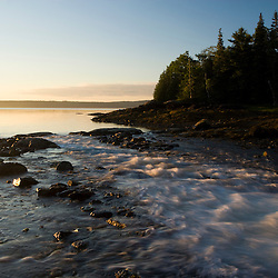 Early morning  in Blue Hill Bay.  Blue Hill Falls, Maine. Water flows from Salt Pond into the bay.